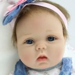 A lifelike baby girl doll suitable for child representation therapy with the person living with dementia