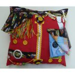 Red square fiddle cushion with cars print