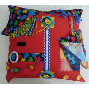 Red square fiddle cushion with jigsaw print