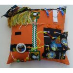 Orange square fiddle cushion with words print