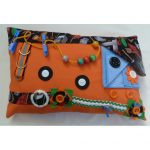 Orange rectangle cushion with tools print