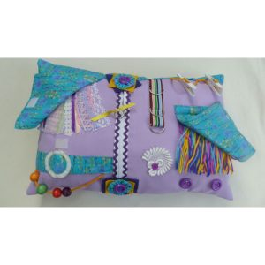 Lilac rectangle fiddle cushion with turquoise floral print