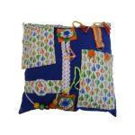 Fiddle cushion - dark blue with hot air balloons print